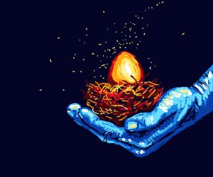 blue hand holds nest