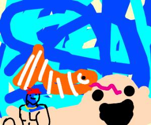 clownfish in ocean w/ happy sand