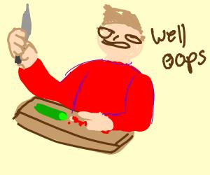 Man chopping a cucumber but cuts his finger