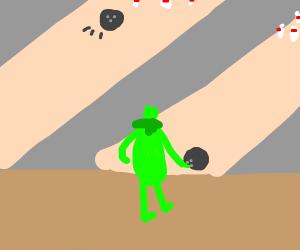 Kermit goes bowling with shrunken head