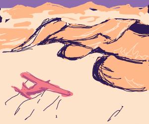 plane flying over the desert