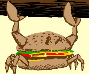 A burger crab holding up a log