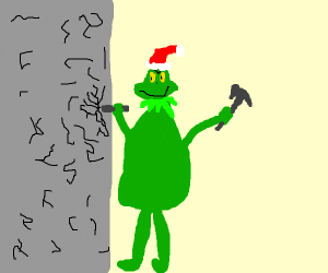 Green man chiseling a rock wall