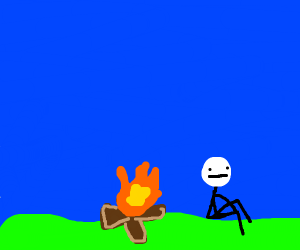 A dude sitting by a campfire