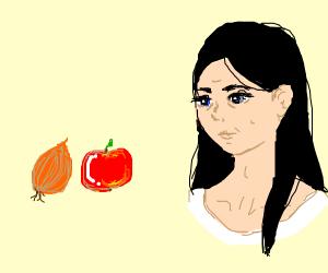 a cute girl beside an apple and an onion