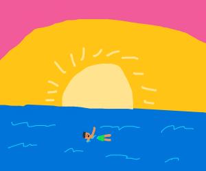 ocean swimming at sunset