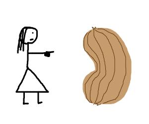 Girl pointing at big peanut