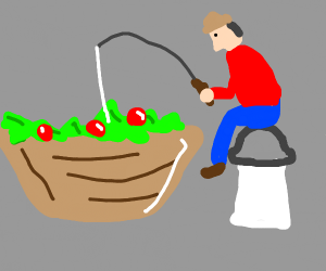 Man fishing in a large salad bowl