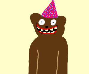 Scary teddy bear wearing a birthday hat