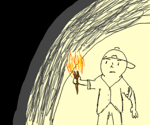 A man with a torch entering a cave