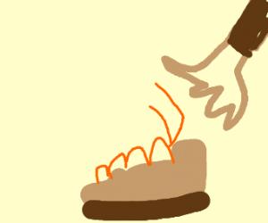 Tying a shoe.