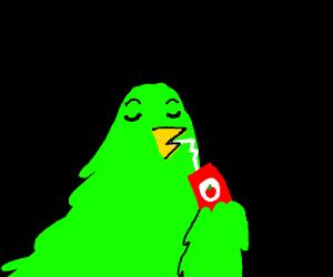 Green bird enjoys apple juice