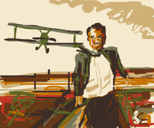 Biplane about to swoop Cary Grant