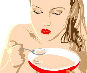 Naked woman eating gravy