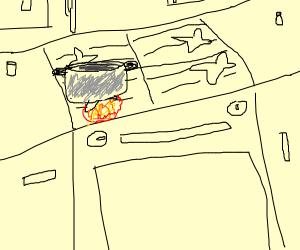 A pot on a stove.