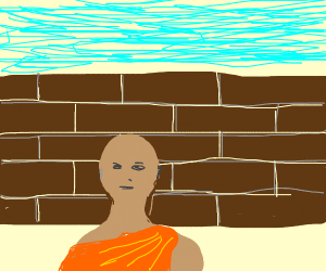 a monk in front of a bricc wall