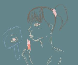 lady puting on lipstick