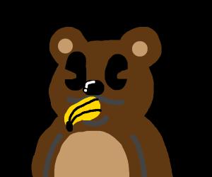 Cute teddy bear eating a banana