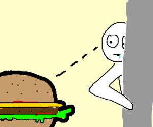 Guy stares a burger