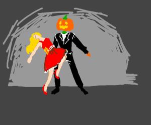 Blonde girl and pumpkinman dancing