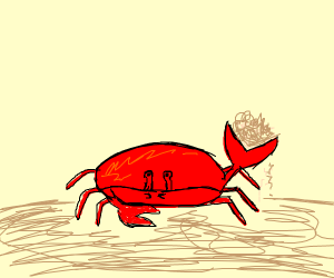 a crab holding some sand