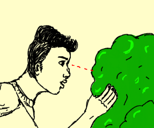 man looks into bush
