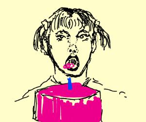 girl eating a pink cake