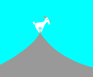 A goat on the peak of a mountain