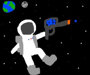 An astronaut with a paint gun