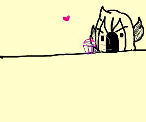 gargoyle eats a cupcake