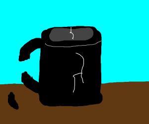 A broken black mug