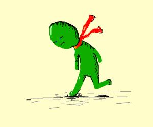 sad green man wearing a red scarf