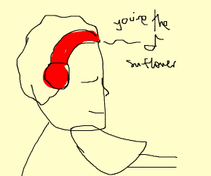 A person in headphones writes near sunflower
