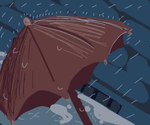 Fallen umbrella in the rain