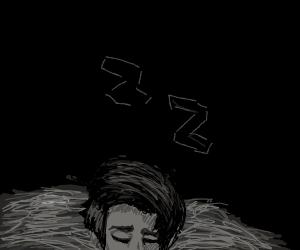 a grey head sleeping in hay