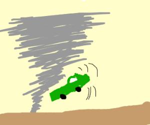 A green truck being swept away by a tornado