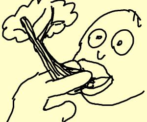 man smokes tree