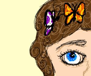 butterflies in girl's curly hair
