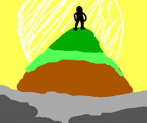 Man stands on foggy mountain