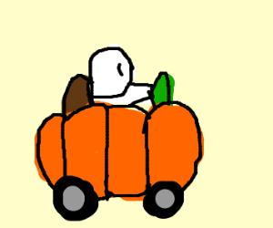 Man driving a pumpkin