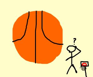 Huge basketball and small hoop.