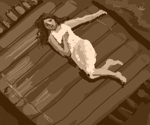 Woman laying on a raft.