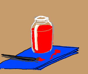 Red paint jar on blue paper