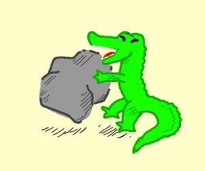 Green animal holding a big rock