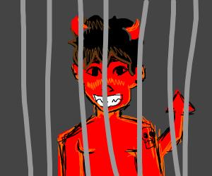 Cute demon behind jail cells