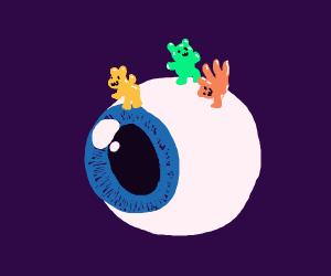 gummybears dancing on an eyeball