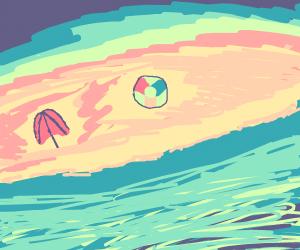beach with a ball and an umbrella