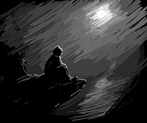 Guy sits on cliff thinking at night