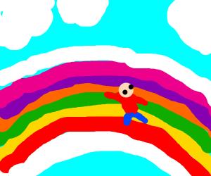 tiny person sliding down giant rainbow slide