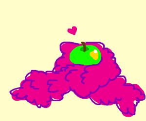 A boa gives an apple a hug